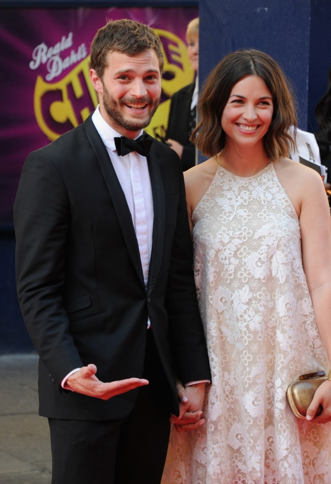 LONDON, ENGLAND - MAY 18: Jamie Dornan (L) and Amelia Warner attend the Arqiva British Academy Television Awards at Theatre Royal on May 18, 2014 in London, England.