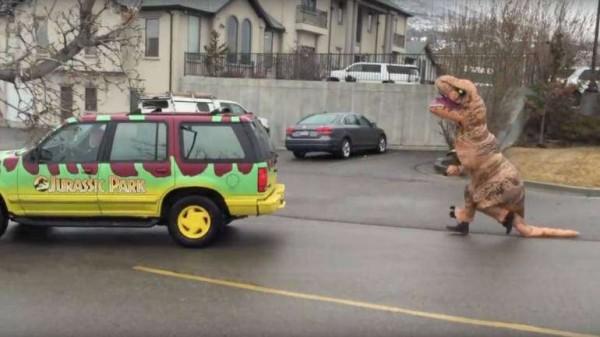 Man Wears T-rex Costume