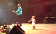 daddy and a baby doing show together