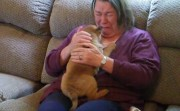 grandma surprised by a puppy