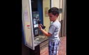 boy and a pay phone